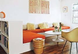interior dazzling small seating in living space with round white coffee table also white sectional