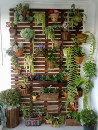 ... Indoor Garden Ideas. Arrange a pallet board and hang several pots on  it. It's easy! And the best part is it will create plenty of vertical space.