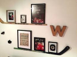 photo collection with hockey stick shelf this would be so cool in our bedroom room decor