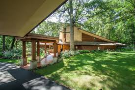as you drive through the lush green woods up to this frank lloyd wright inspired home in springfield wisconsin you will feel at one with nature on a