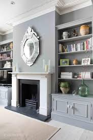 living room victorian lounge decorating ideas. grey lounge with builtin bookcases and lovely fireplace feature mirror london victorian terrace photoshoot location via shootfactory living room decorating ideas