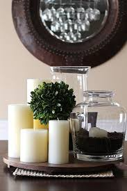 simple centerpiece...candles, jar filled with coffee beans and candle,  greenery