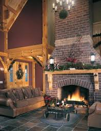 red brick fireplace with wood mantel