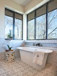 freestanding tub with faucet deck. example of a transitional mosaic tile freestanding bathtub design in austin tub with faucet deck l