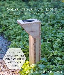 just need a few pieces of cedar you can upgrade the looking of inexpensive path lights