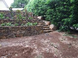 stairs bordered by boulders and retaining walls