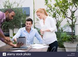 Presenting Project Proposal With Digital Tablet Stock Photo