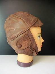 vintage mannequin head with leather vintage car motorcycle hat