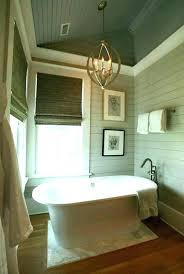 chandelier over tub in bathroom white and gray bathrooms linear crystal