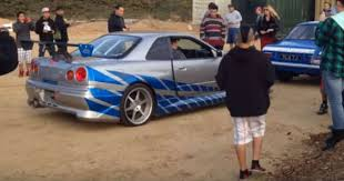 nissan skyline r34 paul walker. Delighful Paul Unseen Video Where The Paul Walker Nissan Skyline R34 GTR Is Being Loaded  On Set  Muscle Cars Zone And R
