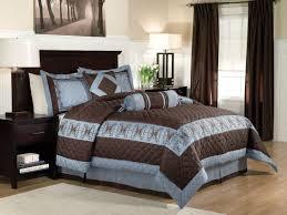 modern bedroom with peninsula suites lofton blue brown king bedding set dark brown panel curtains