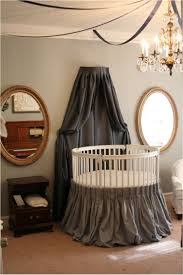 round baby crib with dark canopy