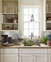 Metal Backsplashes Are Typically Of The Stamped Variety, But A Flat Sheet  Of Galvanized Metal Makes A Clean And Modern Statement In A Country Kitchen  Or ...