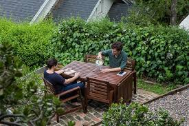 two people sitting at our pick patio dining set in the middle of an
