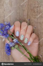 Blue Flower Nail Designs Female Hands Blue Nail Design Holding Blue Flowers Stock