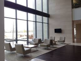 office seating area. Lobby Seating Area Overlooks A Reflection Pool. Located Near The Intersection Of Legacy Drive \u0026 Office I