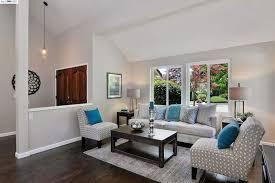living room with brown oak hardwood floors