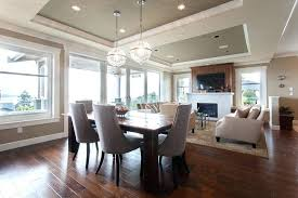 costco home gym bamboo flooring dining room transitional with area rug dining table fireplace glass doors