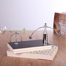 office table decoration. Funny Balance Perpetual Motion Weightlifting Iron Man Toy Pendulum Newton Home Office Table Decoration Hot