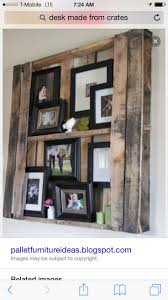 pallet picture frames~ I am wondering if I can find or paint pallets the  right color to liven up the wood panel wall in the living room.