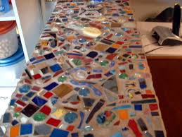 recycled glass tumbled glass tiles tumbled pottery shards broken beads and some fused pieces grouted with sanded grout and sealed