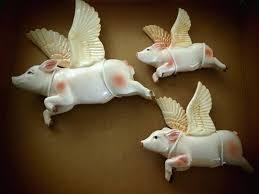 ceramic flying pig wall art