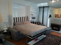... perfectly balanced Murphy bed sofa combination from murphysofa.com  opened MurphySofa sectional with float shelf ...