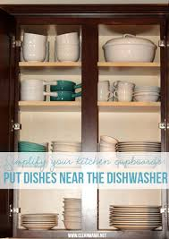 simplify your kitchen cupboards put dishes near the dishwasher via clean mama