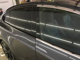 tesla model x chrome delete window trim door handles mirrors base side markers front grill and rear hatch trim vinyl wrapped in satin black