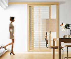 chic design of sliding interior doors made of solid wooden material in brown