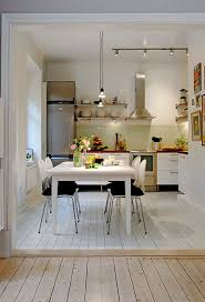 modern apartment kitchen cabinet design with white chairs also