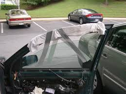 the removal of the window regulator carrier panel requires that the entire weight of the window glass be supported