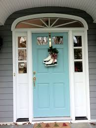 turquoise front door color sherwin williams drizzle decorated and ready for winter