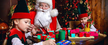 and the elves make gifts for children at work of