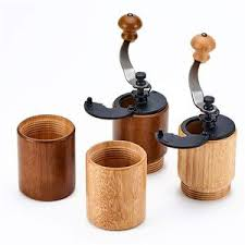 The hand burr coffee grinder functions the way you hold the crank handle and rotate it. Akirakoki Manual Coffee Bean Grinder Light Wooden With Cast Iron Bur Pjt Prime