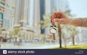Hand Girl Holds The Keys The Concept Of Buying An Apartment Or Car
