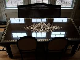 Gold leaf design done on underside of glass table top
