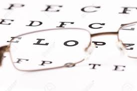A Pair Of Reading Glasses Sitting On A Eye Test Chart With Only