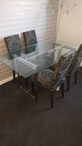 glass dining table with 4 chairs 50