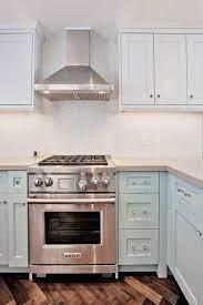 Ice Blue Cabinets Light Gray Quartz Counters Mini Mosaic Marble Backsplash Kitchen Countertops Laminate Contemporary Kitchen Chic Kitchen