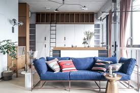 bachelor apartment furniture. Stephen Kenn Sofa With Indigo Denim Cushion Covers And Wooden Furniture In Stylish Studio Apartment | Bachelor V