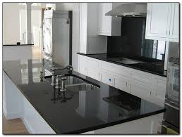 white kitchen cabinets with black countertops. Pictures Of Kitchens With White Cabinets And Black Countertops Kitchen K