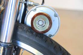 in my first iteration of this e bike i simply epoxied a skateboard wheel to the motor shaft nut and sprocket