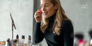 for makeup artist practicing makeup application on herself