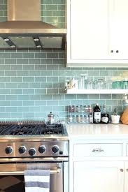 light blue subway tile this is it white cabinets white counters open shelves chrome finish blue light blue subway tile
