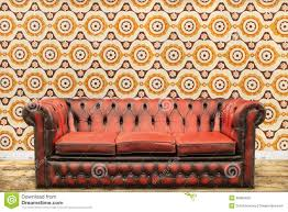Old Sofa Retro Styled Image Of An Old Sofa Against A Vintage Wallpaper Wa