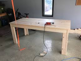 he started by building a relatively simple pine wood table