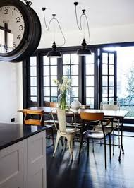modern look for your dining area mix and matched chairs that add a fun and