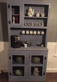 Handmade hutch with black mesh door panels. Finished with Sherwin Williams  bracing blue. Lightly