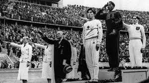 jesse owens nazi era olympic medal up for auction the times of in this aug 11 1936 file photo olympic broad jump medalists salute during